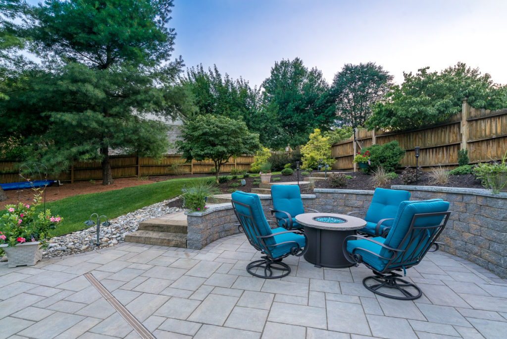 blue patio furniture on outdoor stone patio