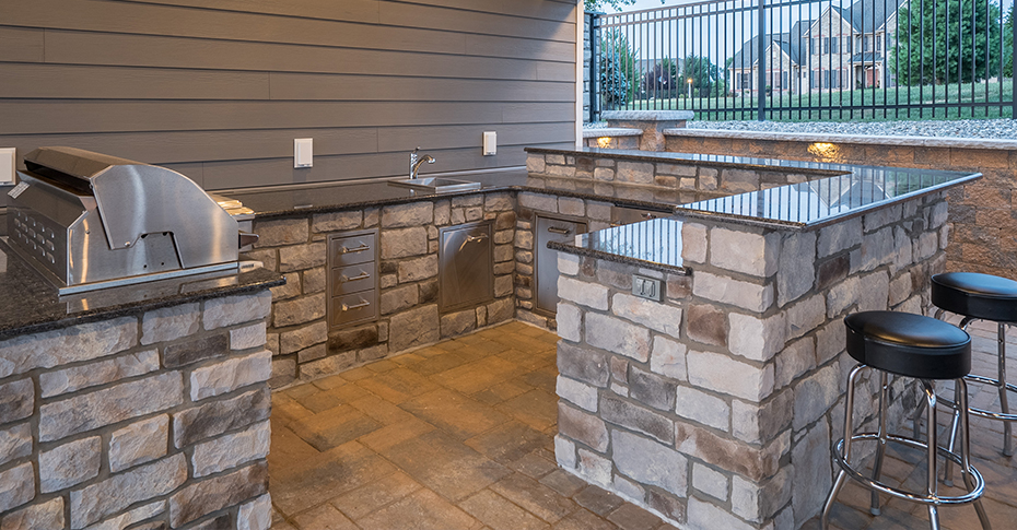 outdoor kitchen area with stools