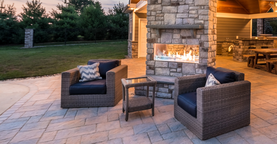 chairs by outdoor fireplace