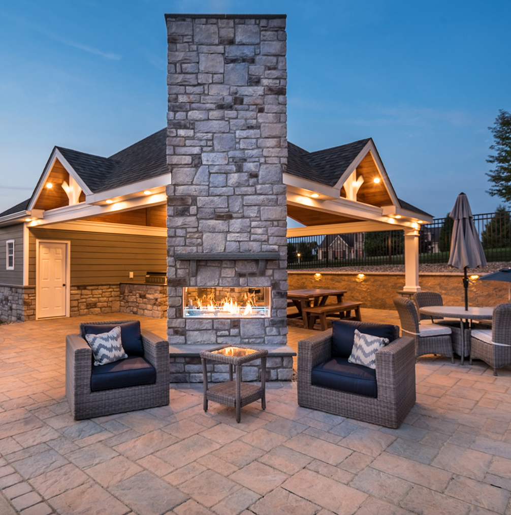 fireplace, outdoor seating and pavilion in back