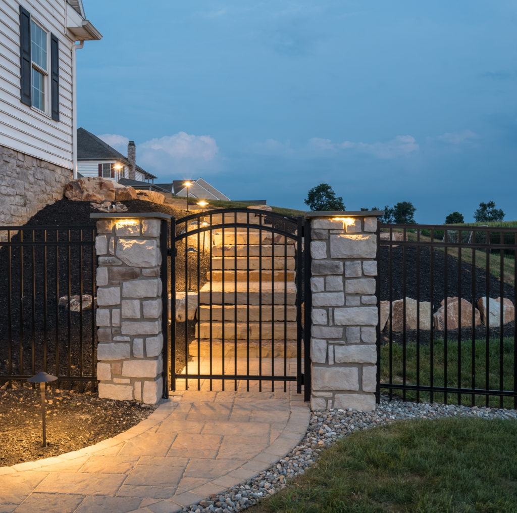 lighted outdoor stairs with gated entrance